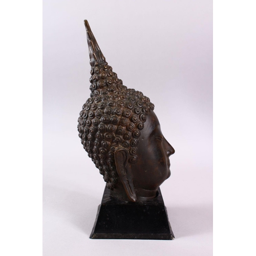 45 - A THAI BRONZE FIGURE OF A HEAD, upon a fitted stand, 36cm high