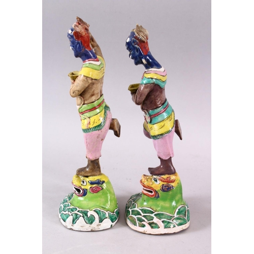 5 - A PAIR OF 19TH CENTURY CHINESE FAMILLE ROSE PORCELAIN GHOST OF QUIXING FIGURES, both stood upon lion...