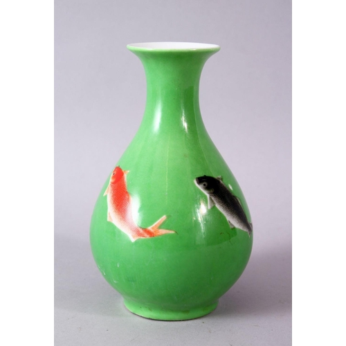 55 - A CHINESE GREEN GLAZED VASE, painted with fish, mark in red, 15cm high.