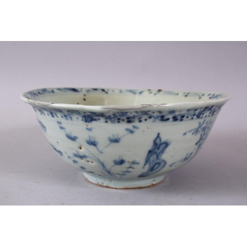 57 - A CHINESE MING BLUE & WHITE PORCELAIN BOWL,decorated with scenes of stylized native flora, 16cm