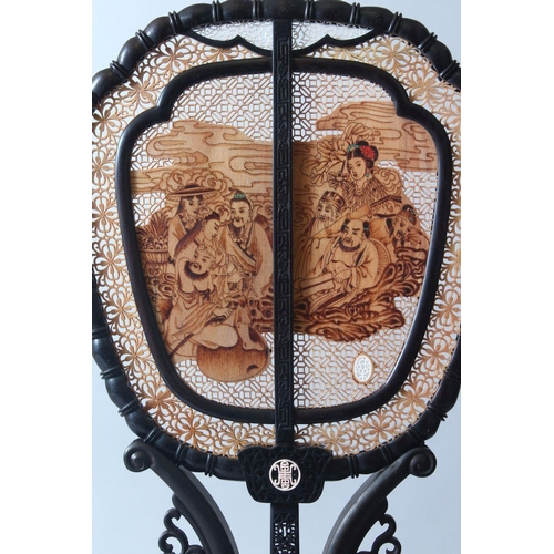 59 - A VERY GOOD CHINESE EBONY, SANDLEWOOD AND IVORY DOUBLE SIDED FAN & STAND, the fan with pierced, carv...
