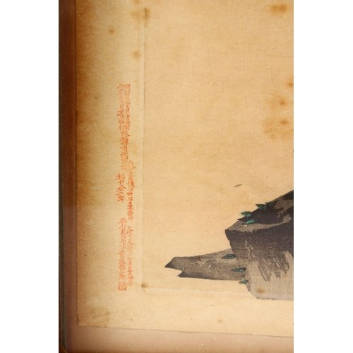 9 - A JAPANESE MEIJI PERIOD WOODBLOCK PICTURE OF TWO CRANES, both cranes stood upon rocky outcrop  at su...