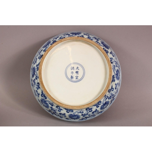 11 - A GOOD CHINESE BLUE AND WHITE PORCELAIN BOX AND COVER, the cover decorated with birds on a peach tre...