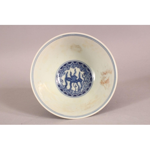 22 - A CHINESE BLUE AND WHITE PORCELAIN STEM CUP, the bowl painted with fish amongst aquatic flora above ...