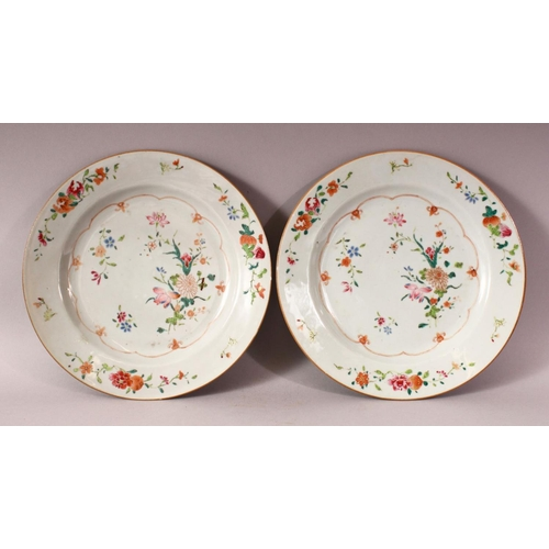 53 - A PAIR OF 18TH CENTURY CHINESE FAMILLE ROSE PORCELAIN PLATES - each decorated with native floral dec...