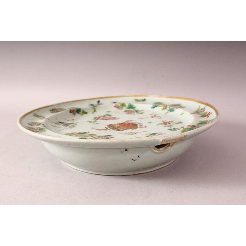 57 - A 19TH CENTURY CHINESE CELADON FAMILLE ROSE PORCELAIN WARMING DISH - The dish decorated with native ...