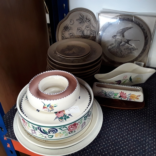 1009 - A collection of Poole pottery stoneware plates together with other Poole pottery items....