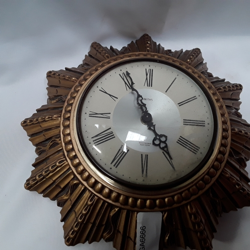 1032 - A wall hanging Smiths sectronic battery sun burst clock....
