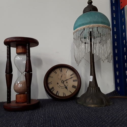 1041 - A decorative lamp, an hour glass and a small reproduction clock....