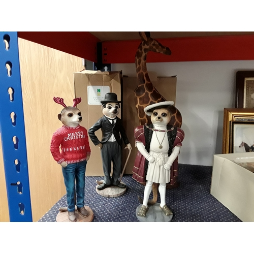 1010 - Three Country Artist's Magnificent Meerkats together with a wooden giraffe....