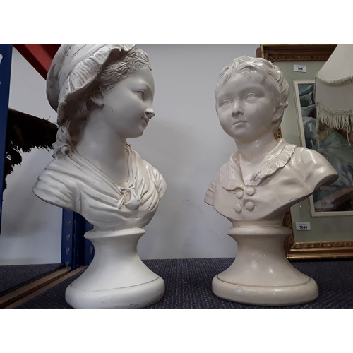 1039 - Two white coloured busts depicting a boy and girl....