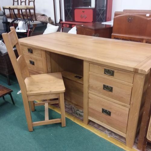 1688 - A large light oak twin pedestal desk with a bareback chair....
