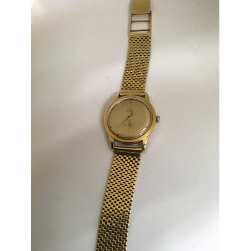 437 - An Omega Seamaster Automatic Gents Wristwatch in 9ct gold on an associated strap, in working order....