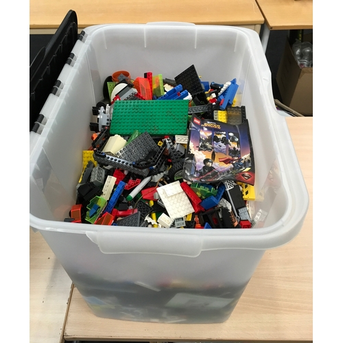 163 - A large plastic box containing loose Lego....