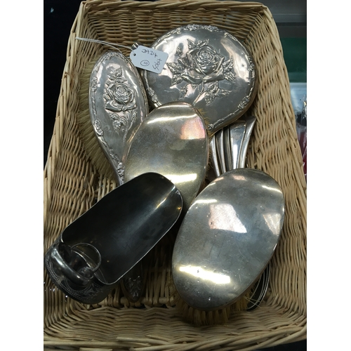 143 - A basket containing silver back mirror and brushes with various plated items....