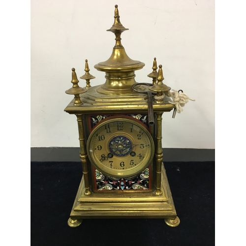 114A - A late 19th century French gilded brass and enamel clock, with key....