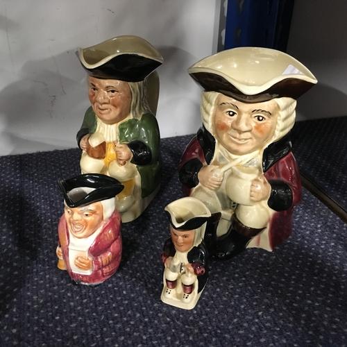 1013 - Four toby jugs....