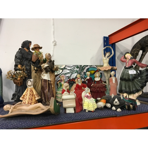 1015 - A quantity of figurines and a tile plaque....