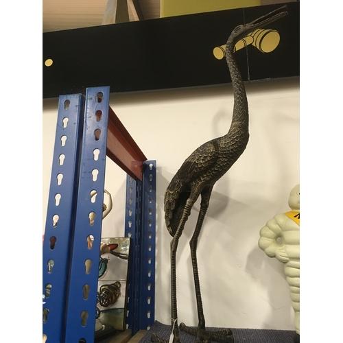1031 - A metal statue of a crane (103)....