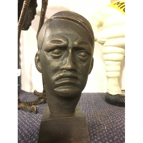 1032 - A cast metal bust of Hitler.(198)....