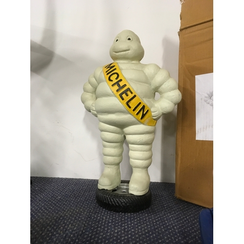 "1033 - A cast model of Michelin Man, 15"" high. (110)...."
