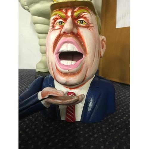1034 - A Donald Trump metal money box. (192)....