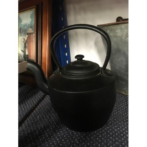 1038 - A cast iron kettle.(42)...