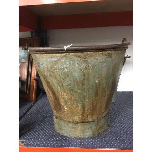 1040 - A large metal pail (128)....