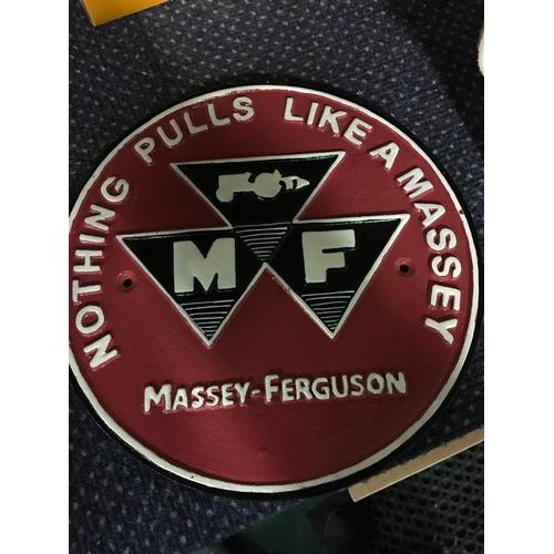 1043 - A cast metal Massey Ferguson sign.(181)...