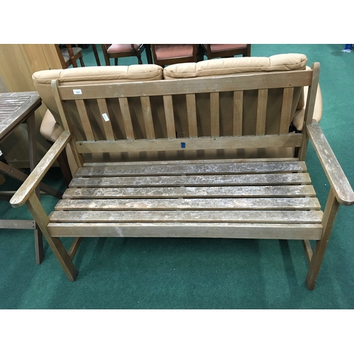 1451 - A two seater wooden garden bench....