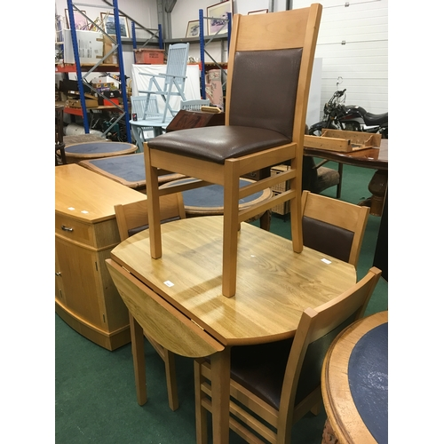 1445 - Round drop leaf dining table plus 4 chairs....