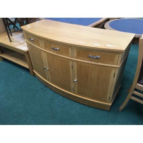 1446 - A modern oak sideboard of three drawers and cupboards....