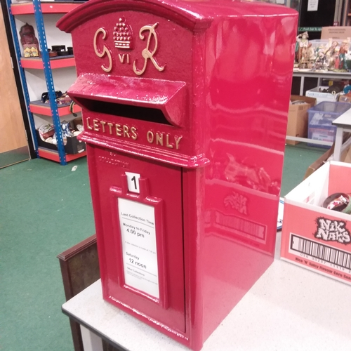 1250 - A large red pillar post box with keys.(41)....