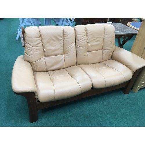 1450 - Two-seater recliner sofa with fawn coloured leather upholstery....