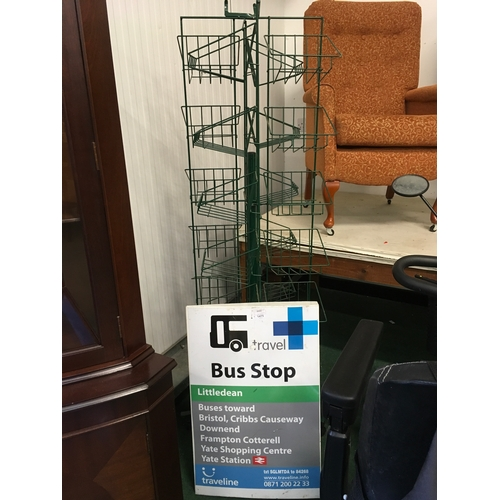 1475 - A display rack and bus stop sign....