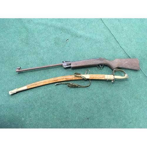 1297 - A pellet gun with a sabre sword....