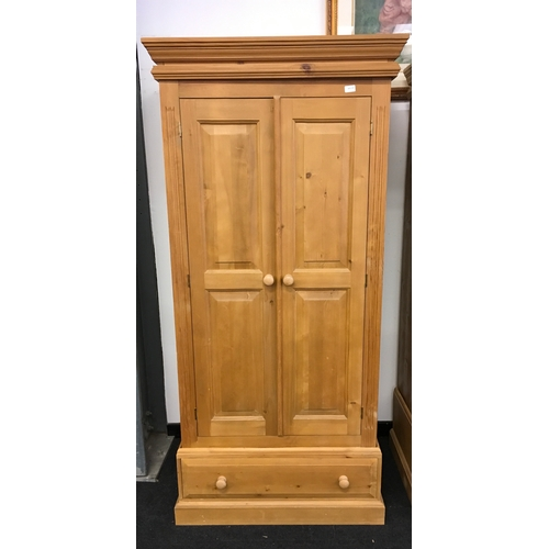 1522 - A single pine wardrobe with drawer to base....