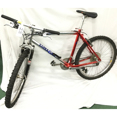 1287 - A Barracuda mountain bike. 18 speed with front suspension. Some rust to chain. (R28)....
