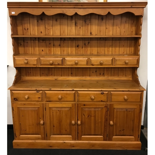 1533 - A large modern pine kitchen dresser....