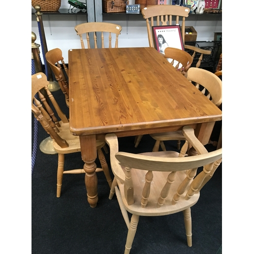 1448 - A modern rectangular pine table with six pine chairs to include two carvers. 78.5cm high. Top: 91 x ...
