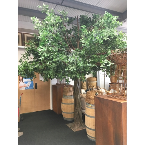 1447 - A large fake tree of resin, plastic and on a metal base. Approximately 12ft high....