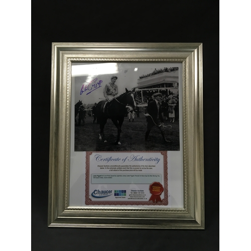 133 - A Lester Piggot framed photograph with signature and Certificate of Authenticity (37cm x 45cm)....