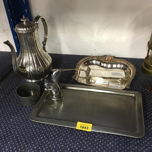 1043 - A silver plated coffee pot with a pewter tray and other similar articles....