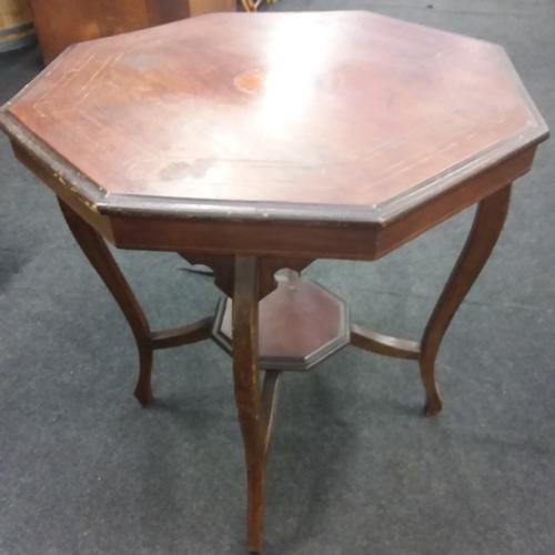 1608 - A mahogany octagonal table....