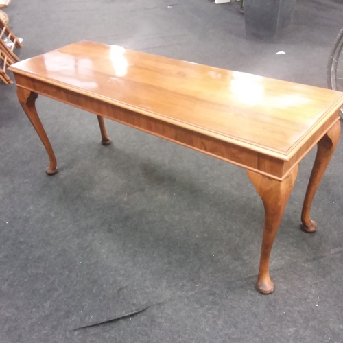 1609 - A coffee table resting on cabriole legs....