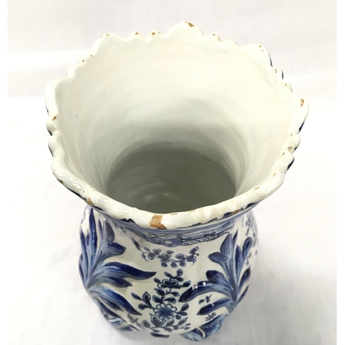4 - A blue and white Delft vase. 26cm high. Chips to rim....