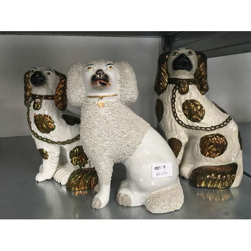 22 - Three Staffordshire dogs....