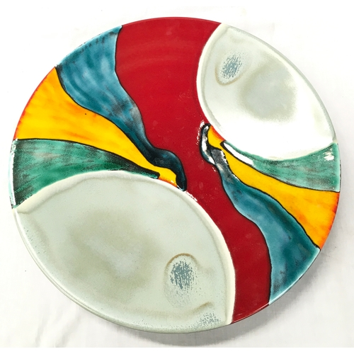 11 - A Poole Pottery charger in the Aurora pattern - 42cm diameter....