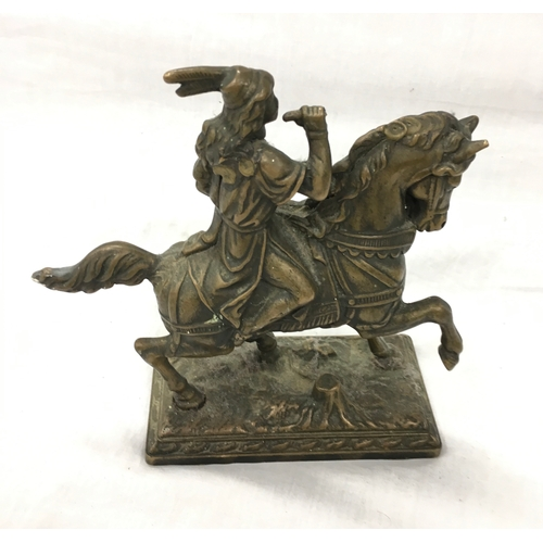 29 - Two metal hunting figures on horseback....