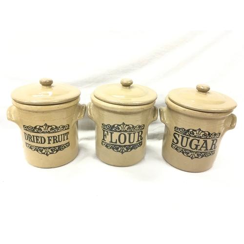 32 - A set of 3 stoneware lidded kitchen pots: